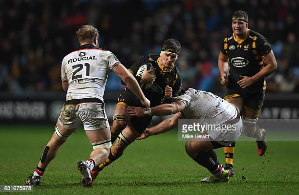 Guy Thompson of Wasps charges at the Toulouse defence during the European Rugby Champions Cup Pool 2 Round 5 match between Wasps and Toulouse at the...
