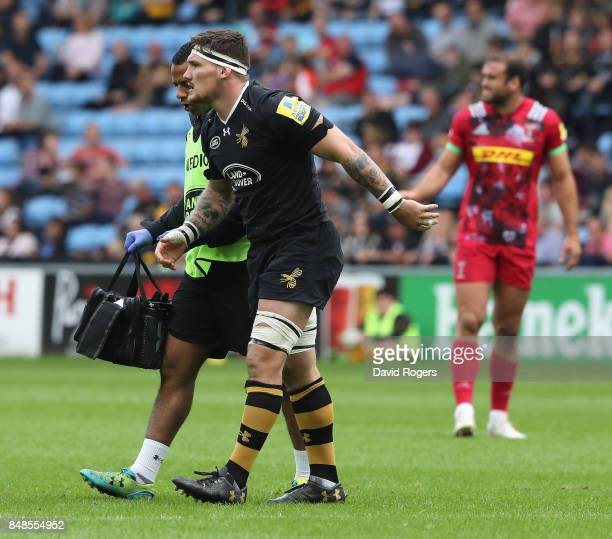 Guy Thompson of Wasps is helped off the pitch after an injury during the Aviva Premiership match between Wasps and Harlequins at The Ricoh Arena on...