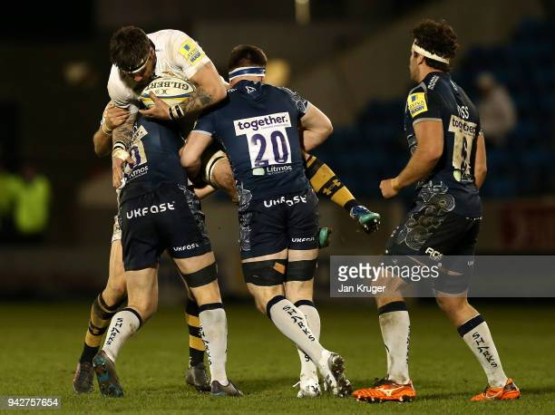 Guy Thompson of Wasps is lifted up by Tom Curry and AJ MacGinty of Sale during the Aviva Premiership match between Sale Sharks and Wasps at AJ Bell...