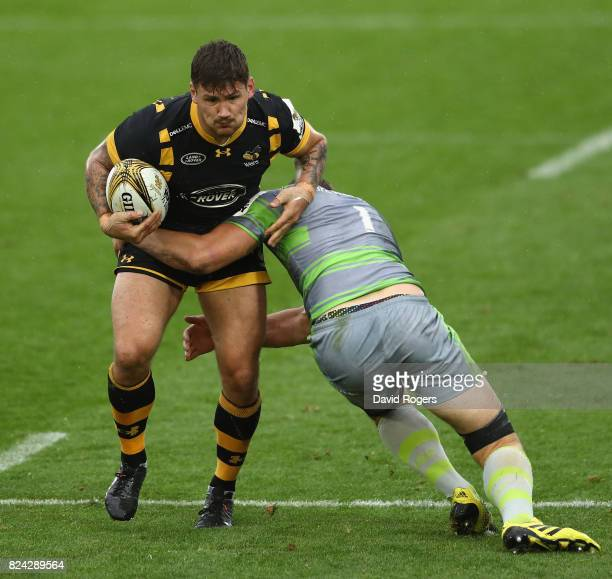 Guy Thompson of Wasps is tackled by Glen Young of Newcastle Falcons in the Cup final during the Singha Premiership Rugby 7s Series Day Two at...