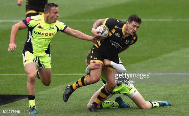 Guy Thompson of Wasps is tackled by the Sale defence during the Singha Premiership Rugby 7s Series Day Two at Franklin's Gardens on July 29 2017 in...