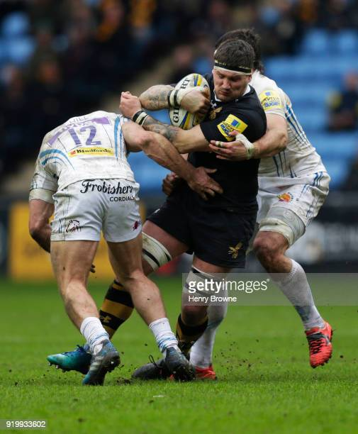 Guy Thompson of Wasps tackled by Don Armand and Sam Hill of Exeter Chiefs during the Aviva Premiership match between Wasps and Exeter Chiefs at The...