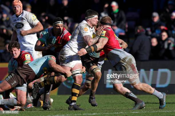 Guy Thompson of Wasps tackled by James Chisholm of Harlequins during the Aviva Premiership match between Harlequins and Wasps at Twickenham Stoop on...