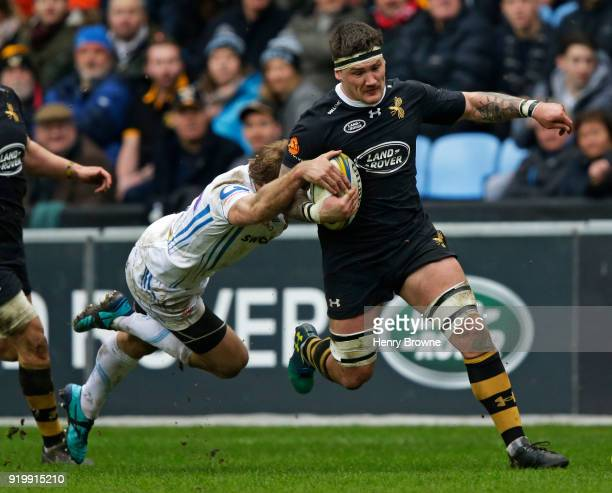 Guy Thompson of Wasps tackled by Lachie Turner of Exeter Chiefs during the Aviva Premiership match between Wasps and Exeter Chiefs at The Ricoh Arena...