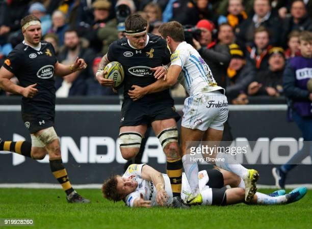 Guy Thompson of Wasps tackled by Santiago Cordero of Exeter Chiefs during the Aviva Premiership match between Wasps and Exeter Chiefs at The Ricoh...