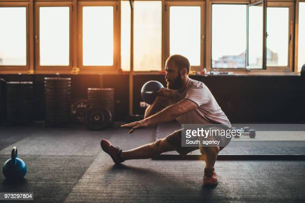 guy training with weights - sports equipment stock pictures, royalty-free photos & images