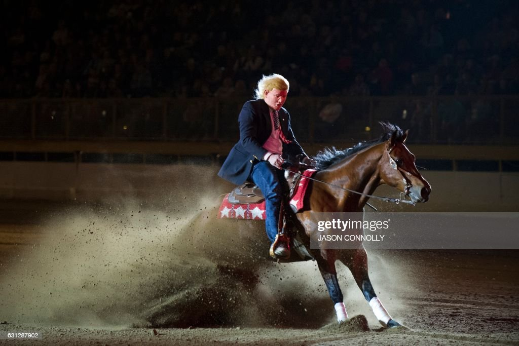 Guy Vernon dressed up in a Donald Trump mask, and riding Outwestkid, competes during the $20,000 RAM Invitational Freestyle Reining competition at the National Western Stock Show in Denver, Colorado on January 8, 2017. Established in 1911, the National Western Stock Show is the premier livestock, rodeo, and horse show in the United States. / AFP PHOTO / Jason Connolly