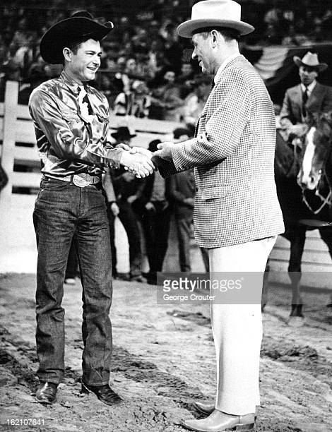 JAN 16 1964 JAN 17 1964 Guy Weeks left of Abilene Tex receives gold trophy belt buckle from Gov John Love Thursday for winning 1963 title of champ...