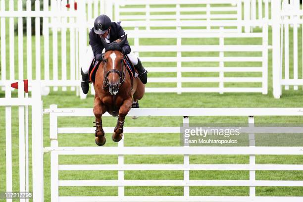 Guy Williams of Great Britain riding Titus competes in The Hickstead Masters Challenge during the British Jumping Derby Meeting on June 24 2011 in...