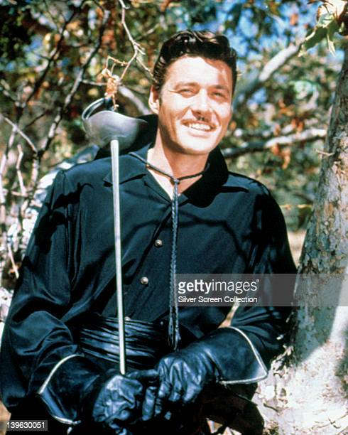 Guy Williams US actor in costume holding his sword over his right shoulder and smiling in a portrait issued as publicity for the US television series...