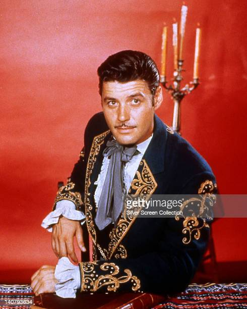 Guy Williams US actor wearing a mariachi costume in a studio portrait against a red background issued as publicity for the US television series...