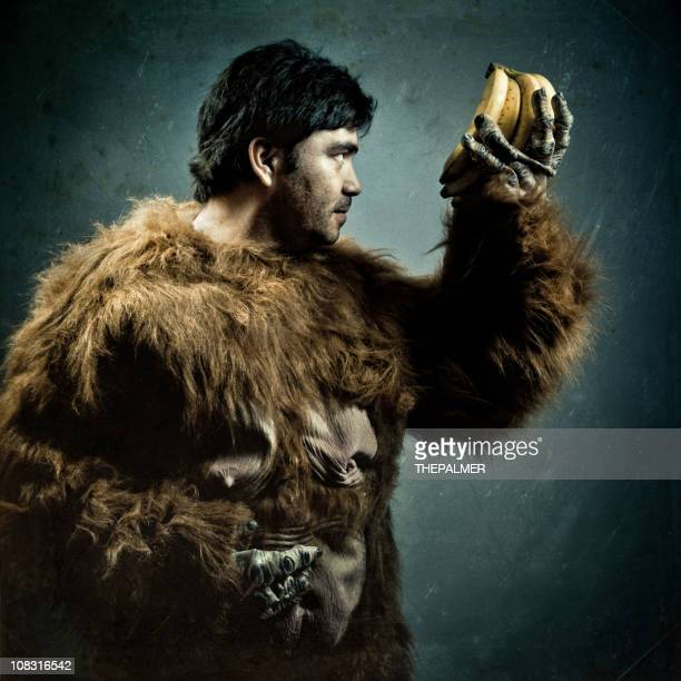 guy with gorilla custome and bananas - hairy man stock pictures, royalty-free photos & images