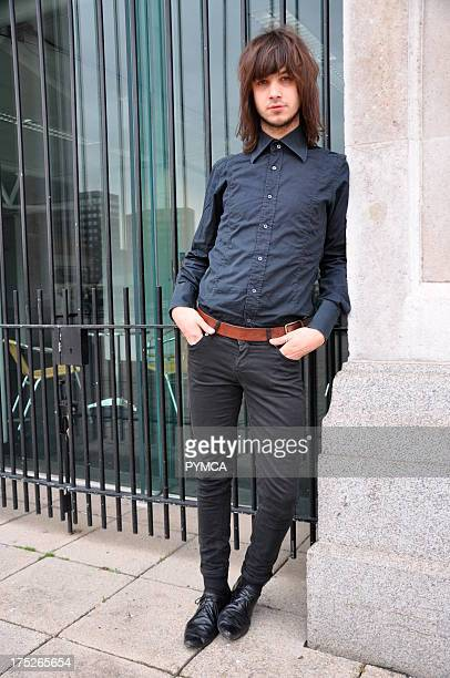 Guy with long hair wearing shirt and skinny jeans Autumn London Fashion Week 2009