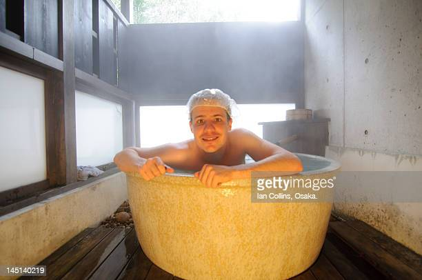 Guy with shower cap in tub