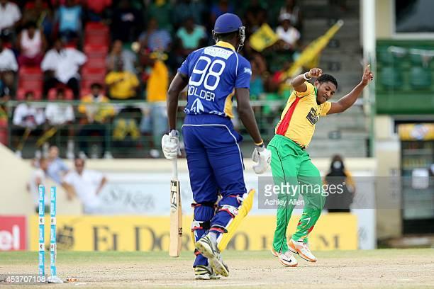 Guyana Amazon Warriors bowler Krishmar Santokie celebrates the wicket of Jason Holder during the Limacol Caribbean Premier League 2014 final match...