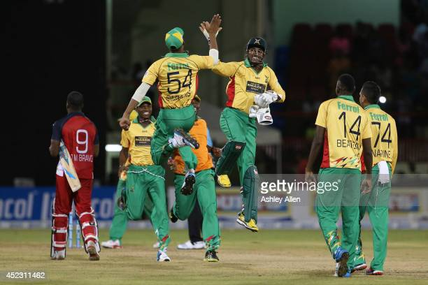 Guyana Amazon Warriors celebrate after winning in the Super Over during a match between Guyana Amazon Warriors and The Trinidad Tobago Red Steel as...