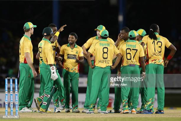 Guyana Amazon Warriors players celebrate a wicket during a match between The Trinidad and Tobago Red Steel and Guyana Amazon Warriors as part of the...