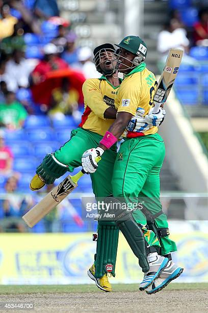 Guyana Amazon Warriors players Denesh Ramdin and Chris Barnwell celebrate during a match between Guyana Amazon Warriors and St Lucia Zouks as part of...