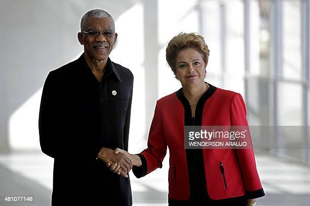 Guyana's President David Granger and Brazil's President Dilma Rousseff shake hands during the welcome ceremony of the MERCOSUR Summit of Heads of...