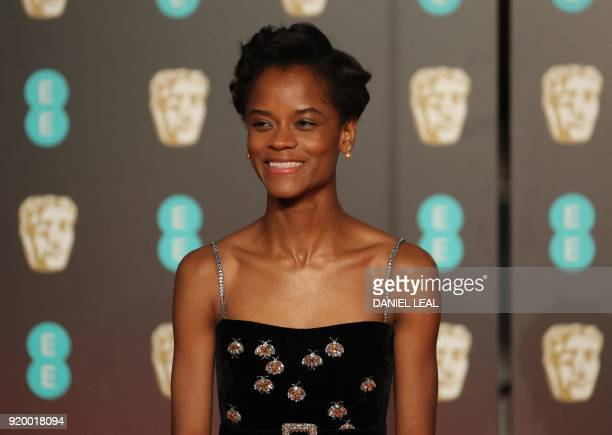 Guyanese actress Letitia Wright poses on the red carpet upon arrival at the BAFTA British Academy Film Awards at the Royal Albert Hall in London on...
