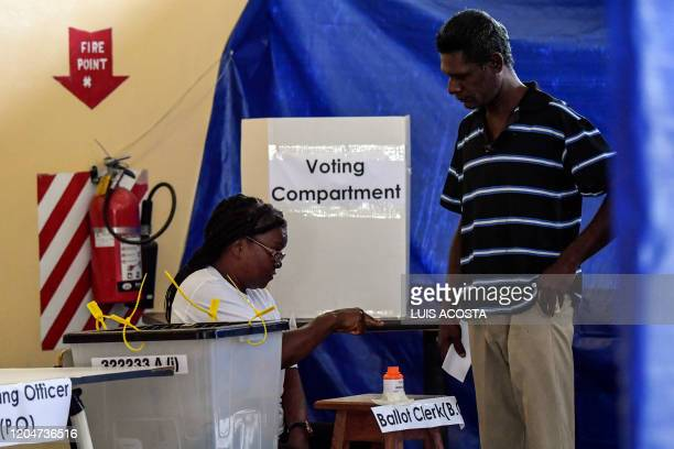 A Guyanese man casts his vote in Leonora Guyana on March 2 2020 Voters in Guyana began casting ballots Monday in a general election to decide which...
