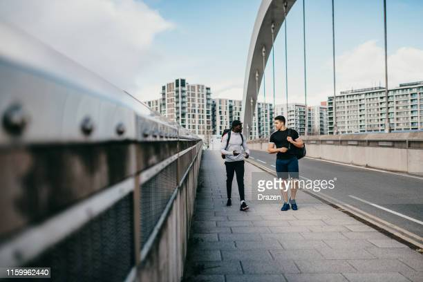 guys going for a outdoor training on cloudy day - muscular build stock pictures, royalty-free photos & images