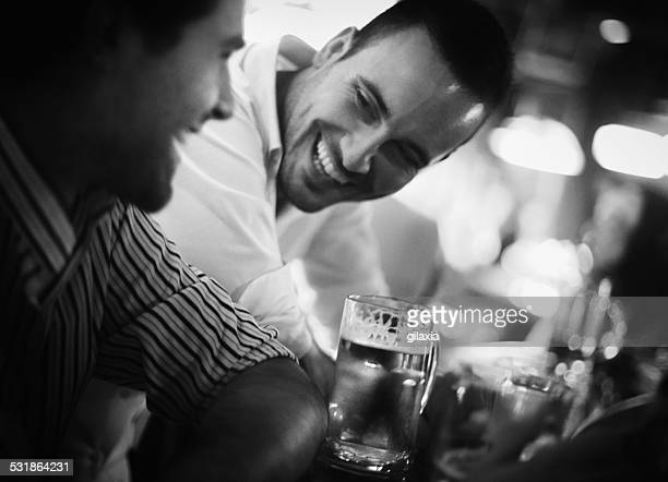 Guys having beer in a bar.