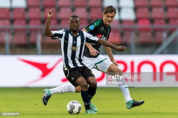 Guytho Mijland of USV Hercules Etienne Reijnen of FC Groningen during the First round Dutch Cup match between USV Hercules and FC Groningen at the...