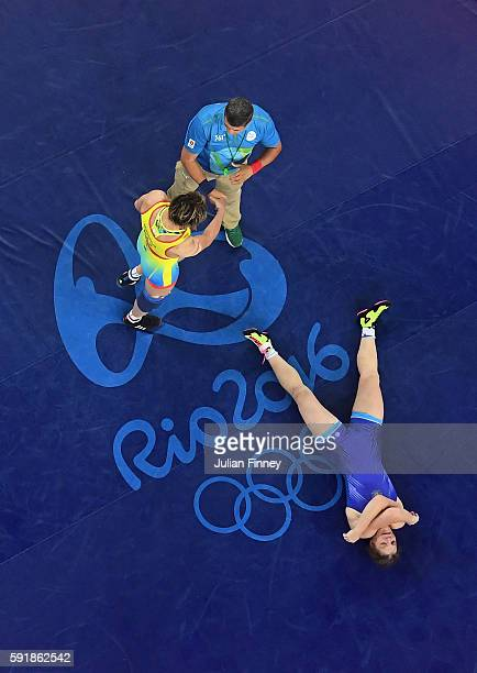 Guzel Manyurova of Kazakhstan celebrates defeating Ekaterina Bukina of Russia during the Women's Freestyle 75 kg Semifinals match on Day 13 of the...