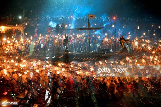 Guzier Jarl Lyall Gair and his Jarl throw their torches onto the galley on January 31 2017 in Lerwick Shetland The traditional festival of fire known...