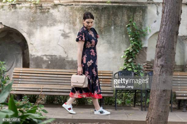Gvantsa Oniani wears a floral Rebecca Taylor dress Chanel purse and Gucci shoes at MercedesBenz Fashion Week Tbilisi on May 5 2017 in Tbilisi Georgia