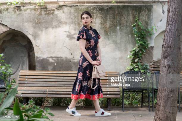 Gvantsa Oniani wears a floral Rebecca Taylor dress, Chanel purse, and Gucci shoes at Mercedes-Benz Fashion Week Tbilisi on May 5, 2017 in Tbilisi,...