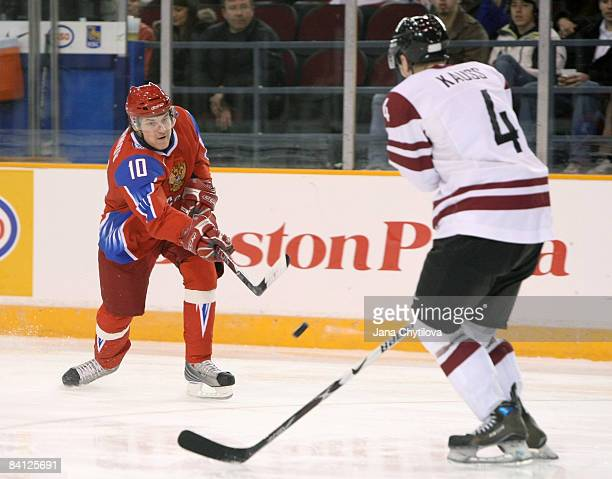 Gvido Kauss of Latvia tries to block the shot of Pavel Chernov of Russia at the Civic Centre on December 26, 2008 in Ottawa, Ontario, Canada.