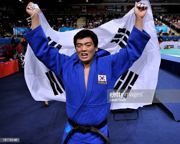 GwangGeun Choi of Republic of Korea proudly holds the South Korean flag after winning the u100kgs final on Day 3 of the London 2012 Paralympic Games...