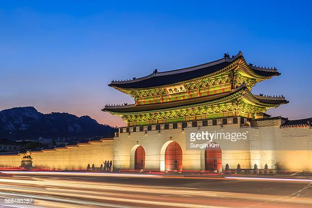 gwanghwamun gate with traffic trails at night - gyeongbokgung stock photos and pictures
