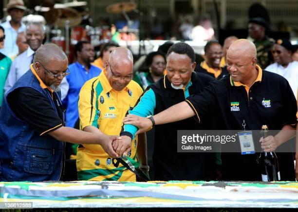 Gwede Mantashe, Jacob Zuma, Kgalema Mothlanthe and Jeff Radebe cutt the centenery cake at the Mangaung stadium during celebrations of the centenary...