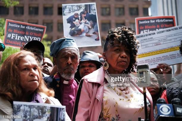 Gwen Carr, mother of Eric Garner, joins others during a news conference outside of Police Headquarters in Manhattan to protest during the police...