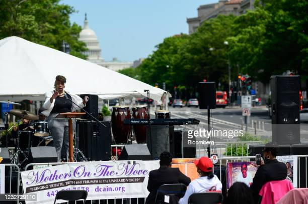 """Gwen Carr, mother of Eric Garner, left, speaks during a """"Hear the Cry"""" rally at Freedom Plaza near the U.S. Capitol in Washington, D.C., U.S., on..."""