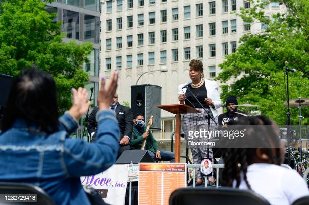 """Gwen Carr, mother of Eric Garner, right, speaks during a """"Hear the Cry"""" rally at Freedom Plaza in Washington, D.C., U.S., on Thursday, May 6, 2021...."""
