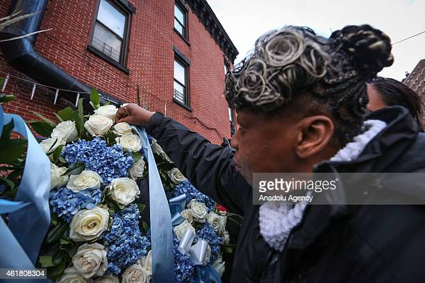 Gwen Carr mother of Eric Garner who killed during a scuffle with police last year lay wreaths and say a prayer at the site where police officers...