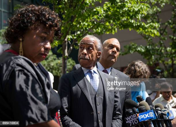 Gwen Carr mother of the late Eric Garner and Rev Al Sharpton listen to questions from the press after meeting with Department of Justice officials...