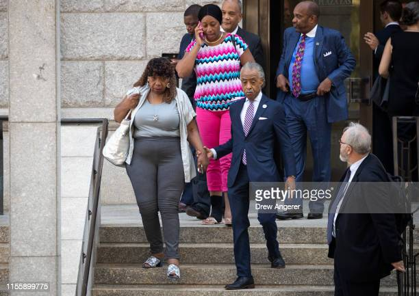 Gwen Carr mother of the late Eric Garner walks with Rev Al Sharpton as they exit the US Attorney's office following a meeting with federal...