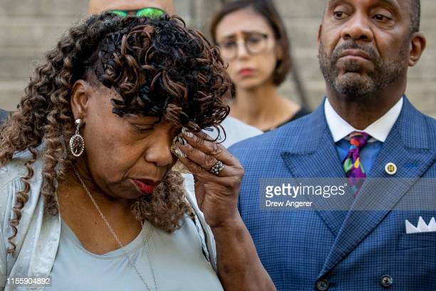 Gwen Carr mother of the late Eric Garner wipes away tears after speaking to the press outside the US Attorney's office following a meeting with...