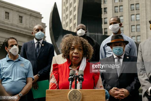 Gwen Carr racial justice activist and mother of Eric Garner speaks at a press conference calling for a ban on police chokeholds in Foley Square on...