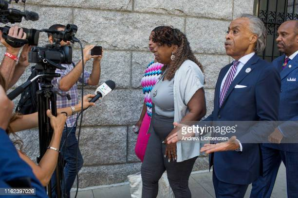 Gwen Carr the mother of Eric Garner and Rev Al Sharpton leave the Federal Court House after being informed in a private meeting that prosecutors...