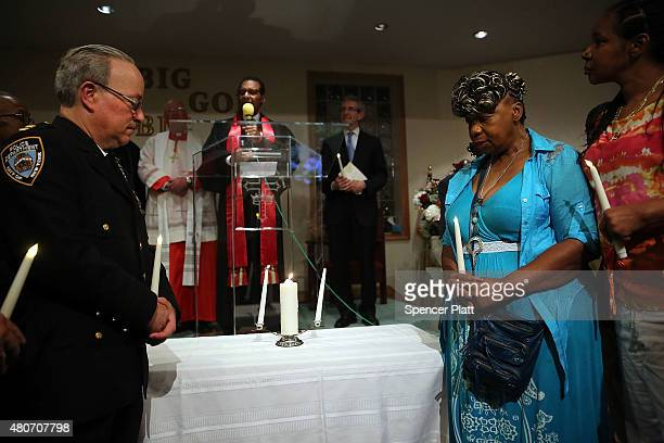 Gwen Carr the mother of Eric Garner stands with Staten Island Borough Commander Chief Edward Delatorre in a joint candle lighting at an interfaith...