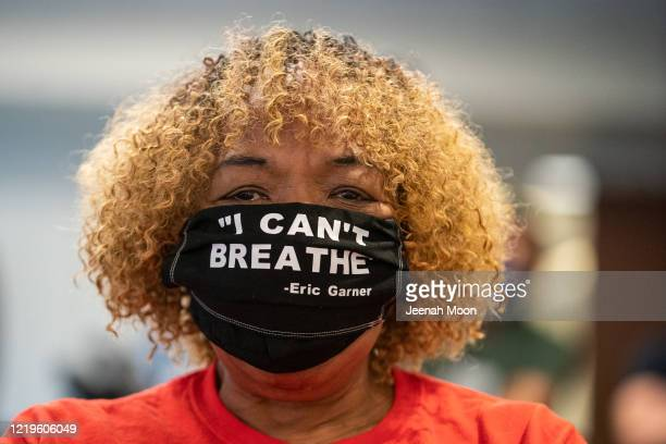 Gwen Carr the mother of Eric Garner wearing a protective mask attends New York Governor Andrew Cuomo's daily media briefing at the Office of the...
