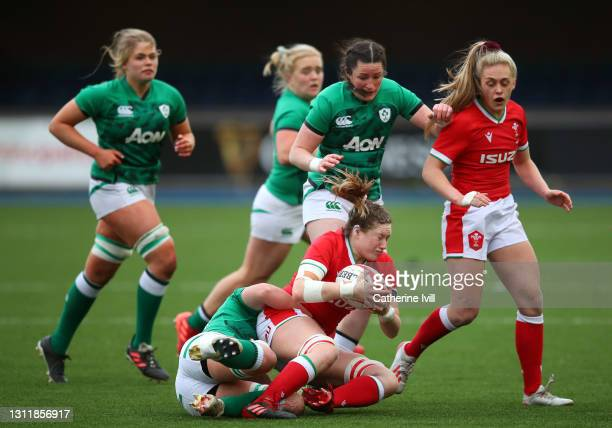 Gwen Crabb of Wales is brought down during the Women's Six Nations match between Wales and Ireland at Cardiff Arms Park on April 10, 2021 in Cardiff,...