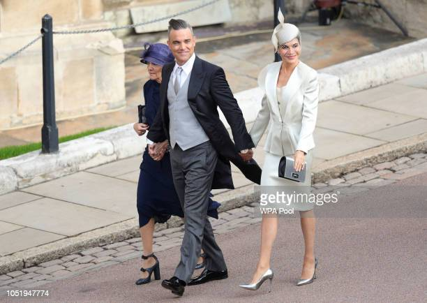Gwen Field, Robbie Williams and Ayda Field arrive ahead of the wedding of Princess Eugenie of York and Mr. Jack Brooksbank at St. George's Chapel on...