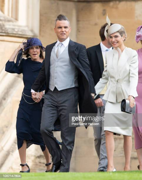Gwen Field Robbie Williams and Ayda Field attend the wedding of Princess Eugenie of York and Jack Brooksbank at St George's Chapel in Windsor Castle...